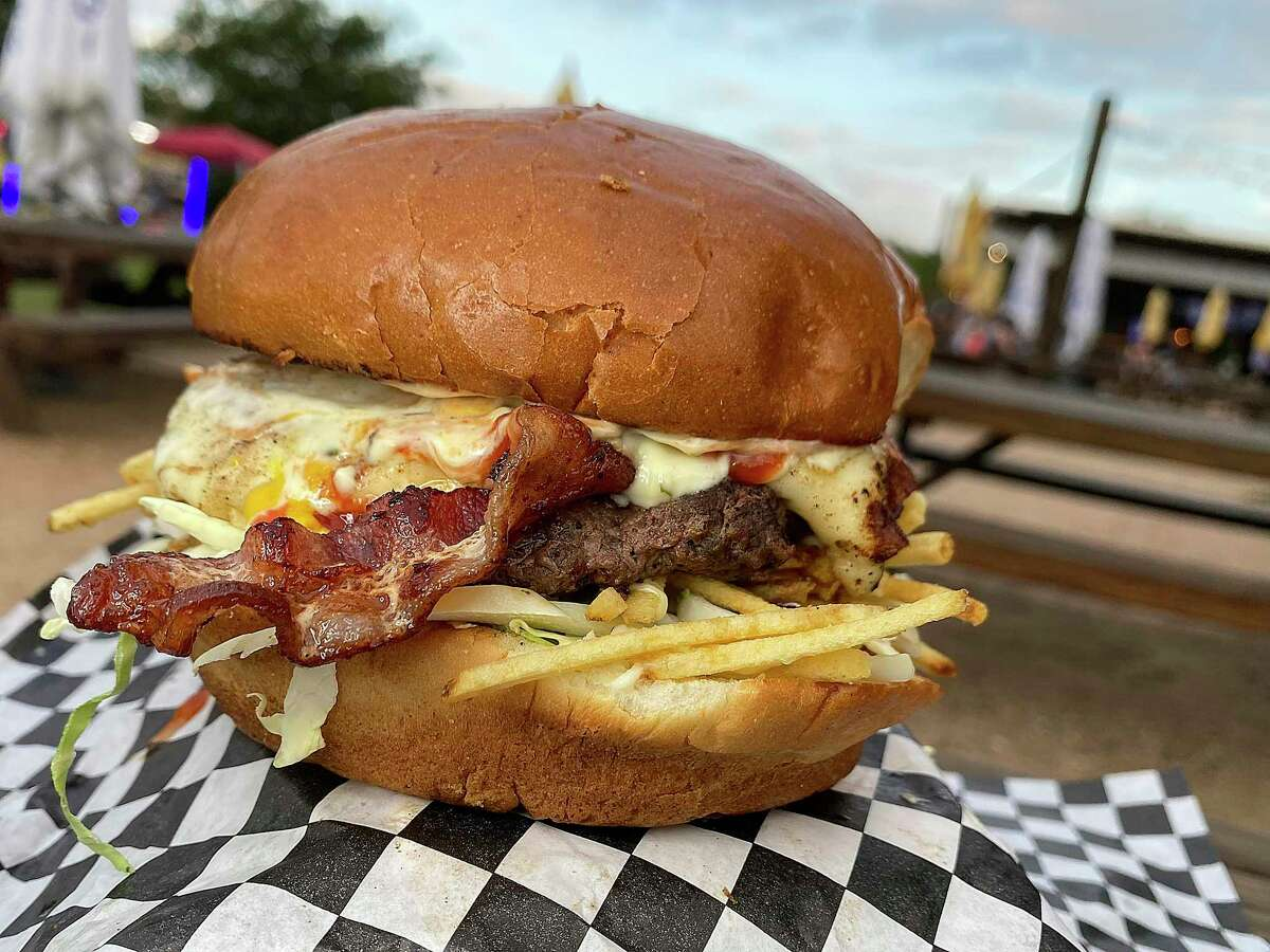 The Venezuelan Burger comes with beef, cheese, cabbage, bacon, tomatoes and potato sticks at Zulia's Kitchen, a Venezuelan food truck at The Block SA food truck park.