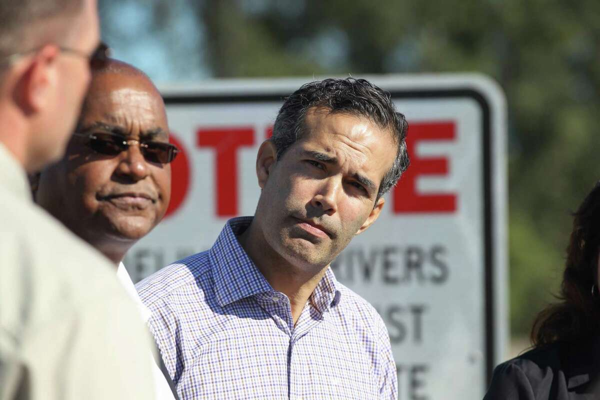 Texas General Land Office Commissioner George P. Bush listens to Executive Director of the Harris County Flood Control District Russell