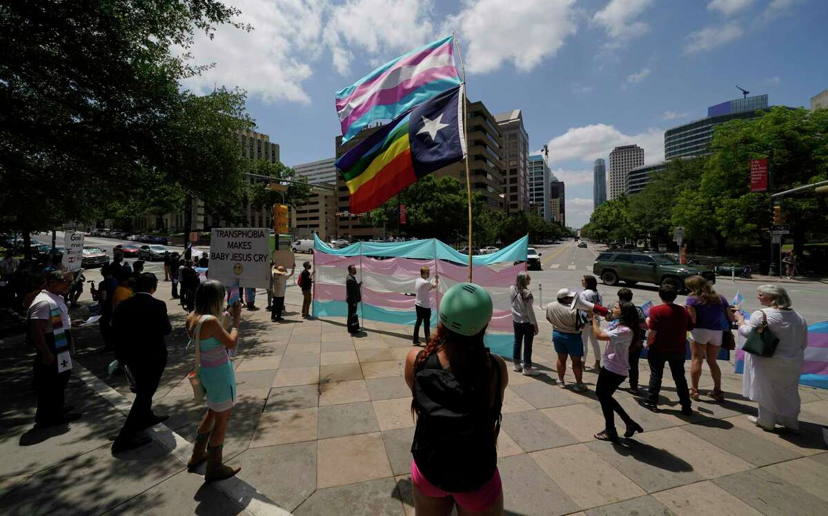 Demonstrators gather on the steps to the State Capitol to speak against transgender related legislation bills being considered in the Texas Senate and Texas House, Thursday, May 20, 2021, in Austin, Texas. (AP Photo/Eric Gay)