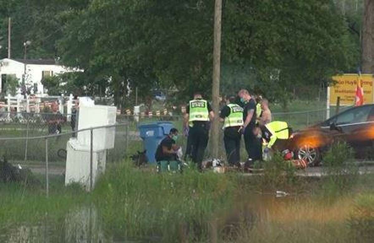 First responders can be seen on FM 1485 in New Caney as they work on a teenage boy who was electrocuted.