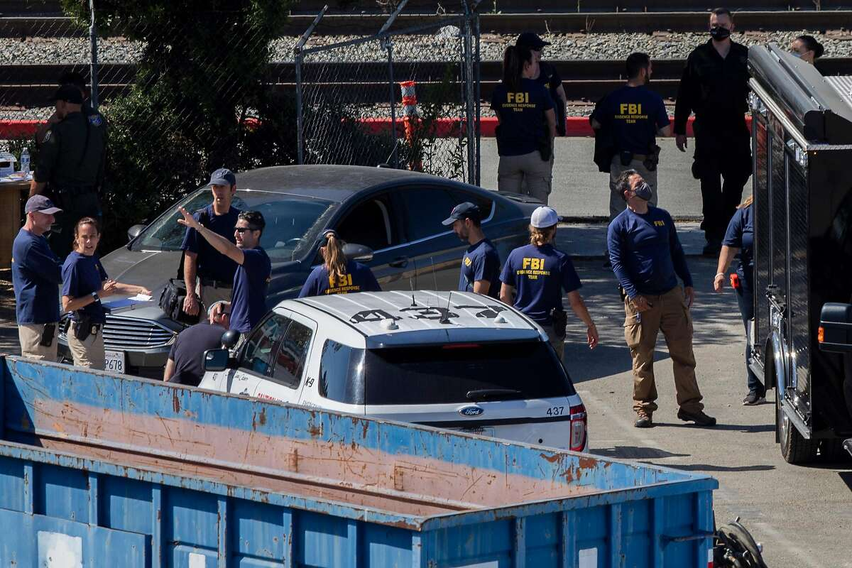 FBI at the VTA Light Rail Facility yard, Wednesday, May 26, 2021, in San Jose, Calif. A shooting at the light-rail yard near downtown San Jose left nine people dead, including the gunman.