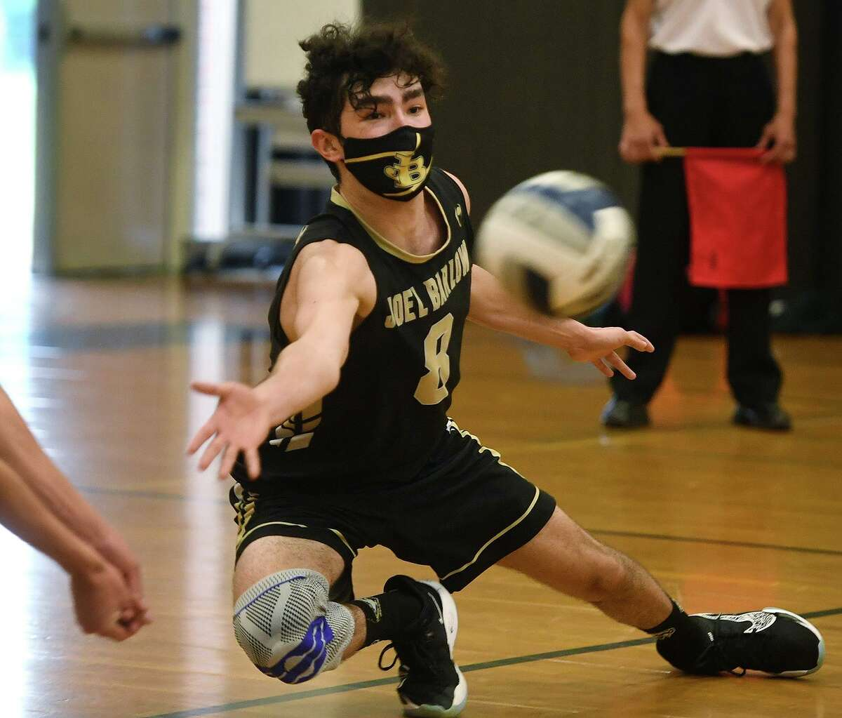 Barlow's Rhys Robichaud reaches to dig the ball during Barlow's 3-0 victory over Newtown in the SWC boys volleyball championship on Wednesday.