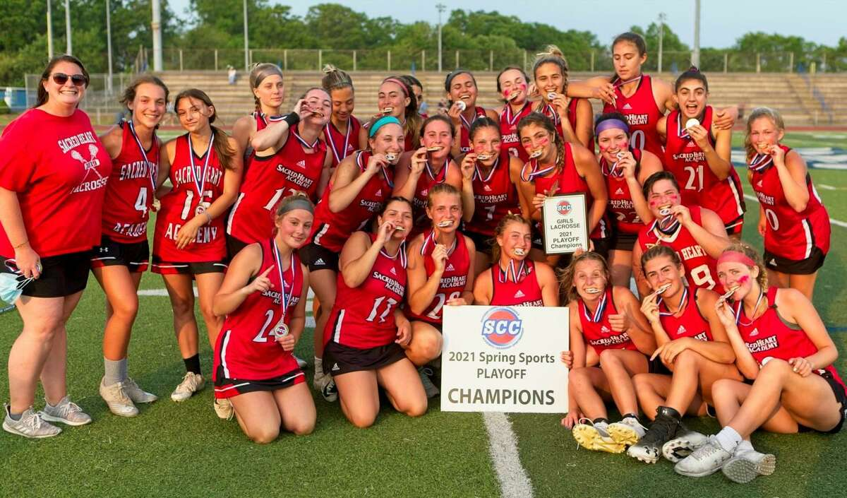 Sacred Heart Academy celebrates it's 9-8 double overtime win over Amity Regional in the SCC Division II championship on Wednesday, May 26, 2021 at Ken Strong Stadium in West Haven, Conn.