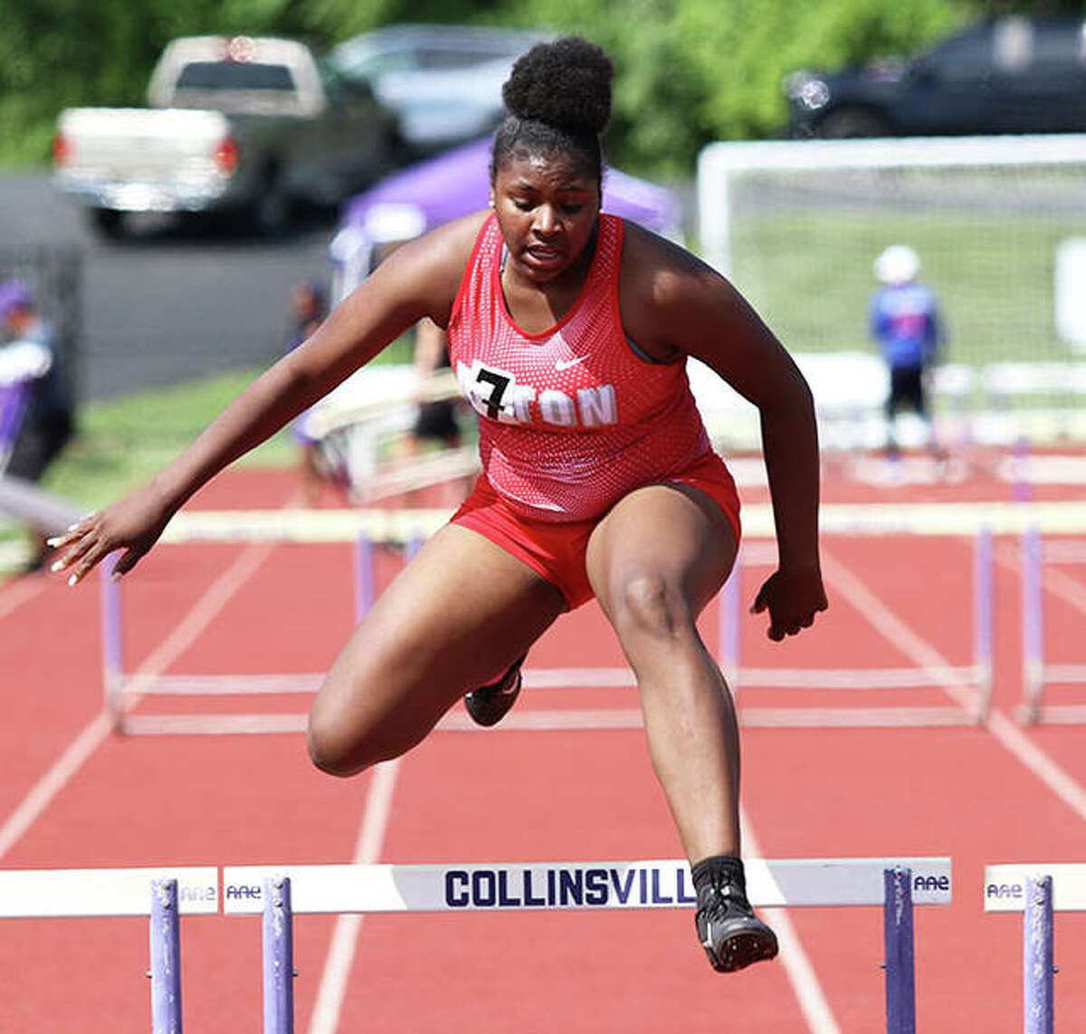 Alton's Savannah McMurray clears the final hurdle in the 300-meter hurdles Wednesday at the Southwestern Conference girls track meet at Collinsville.