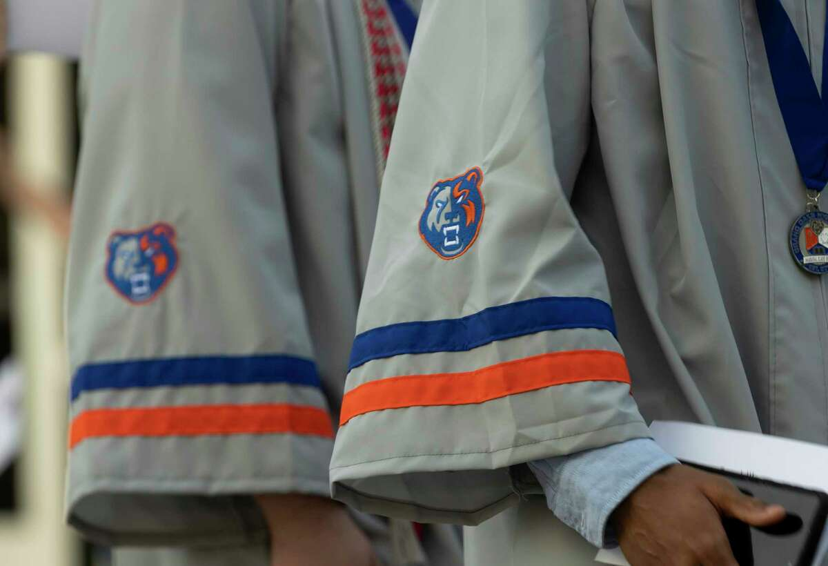 Grand Oaks logo is seen on graduation gowns during Grand Oaks High School's graduation ceremony at the Cynthia Woods Mitchell Pavilion, Wednesday, May 26, 2021, in The Woodlands.