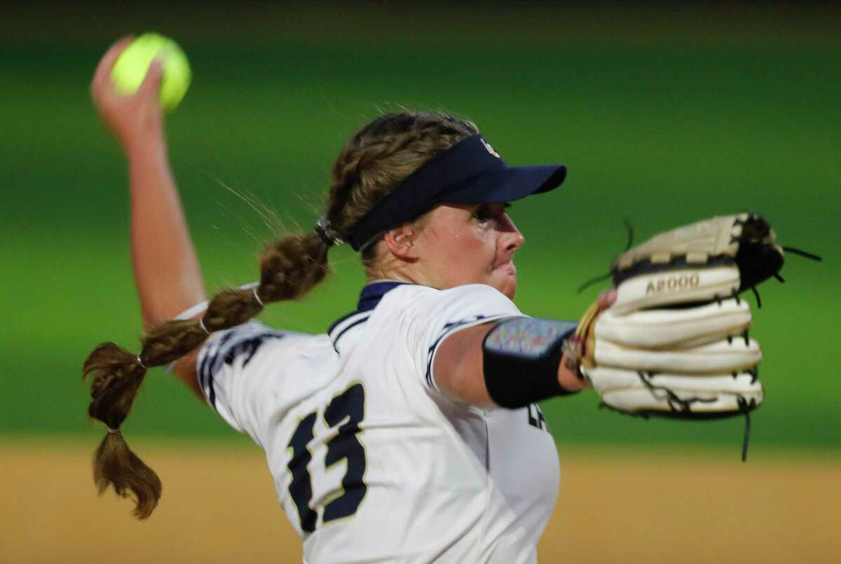 FILE PHOTO - Lake Creek pitcher Emiley Kennedy (13) throws in the seventh inning of a one-game Region III-5A semifinal at Grand Oak High School, Thursday, May 20, 2021, in Spring.