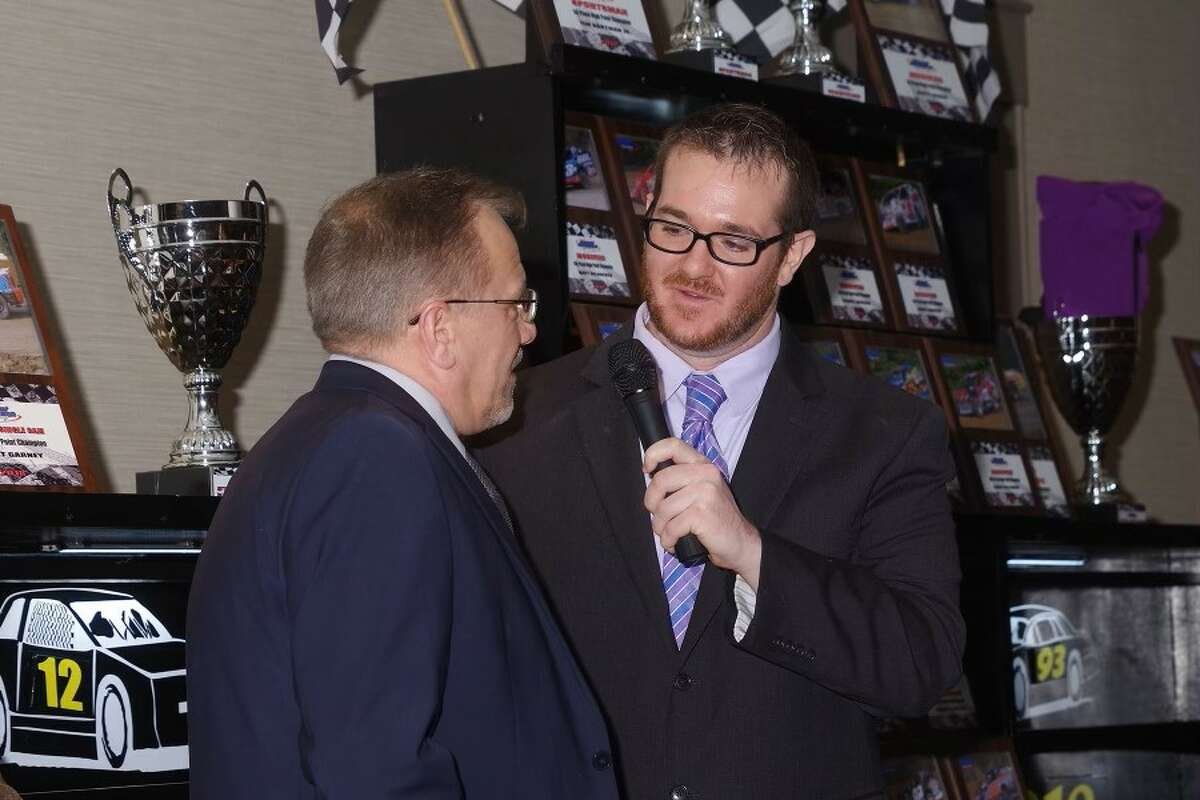 Announcer Mike Warren, right, at work. He is now the PR director for the World of Outlaws Late Model Series.