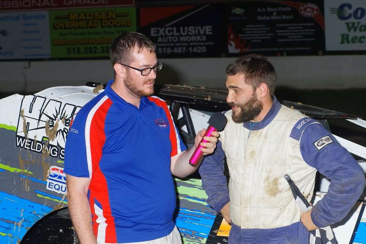 Announcer Mike Warren, left, at work. He is now the PR director for the World of Outlaws Late Model Series.