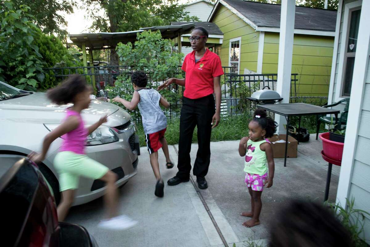 Janelle Ivy, a rent relief recepient, watches her children play outside her sister's house Wednesday, May 26, 2021 in Houston. The City of Houston and Harris County launched the joint $159 million rent relief fund in February, marking the largest local investment in aid since the pandemic sparked a housing crisis for renters who saw their incomes plunge when businesses shuttered. Another $93 million in federal rent relief grants is heading to the city's coffers, even as government and nonprofits still are working to distribute about half of an earlier $159 million allotment.