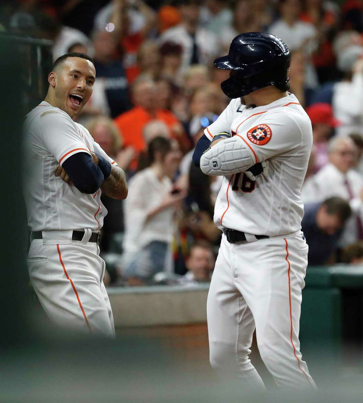 Houston Astros Aledmys Diaz (16) celebrates with Carlos Correa after hitting a home run off of Los Angeles Dodgers Nate Jones during the seventh inning of an MLB baseball game at Minute Maid Park, Wednesday, May 26, 2021, in Houston.