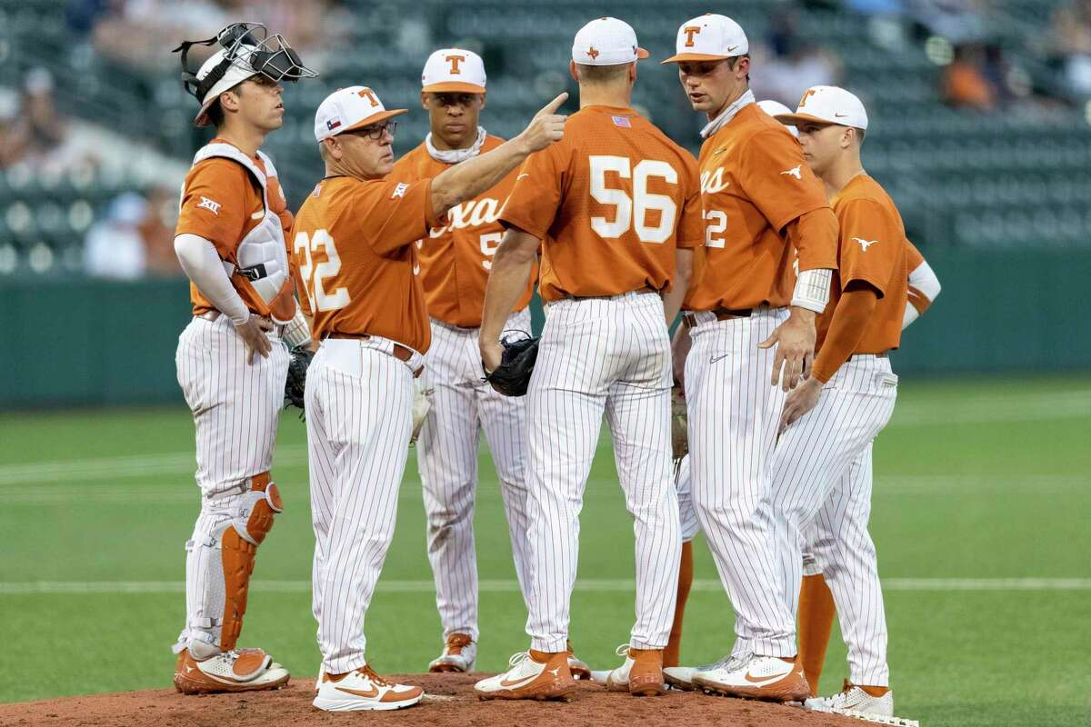 Coach David Pierce, second from left, saw top seed UT suffer a 5-1 loss Wednesday to No. 8 seed West Virginia in the first round of the Big 12 baseball tournament at Oklahoma City. The Longhorns will face either Oklahoma or Oklahoma State on Thursday in an elimination game.