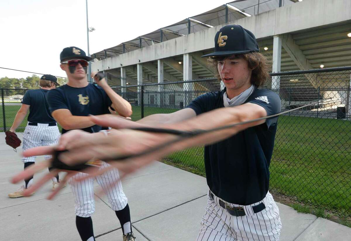 Lake Creek pitcher Shane Sdao (6) warms up before Game 1 of a Region III-5A high school baseball semifinal series at Humble High School, Wednesday, May 26, 2021, in Humble.