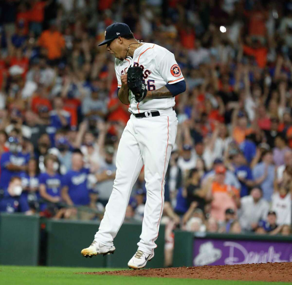 Houston Astros relief pitcher Bryan Abreu reacts after striking out Los Angeles Dodgers Albert Pujols for the final out of an MLB baseball game at Minute Maid Park, Wednesday, May 26, 2021, in Houston. Astros won 5-2.