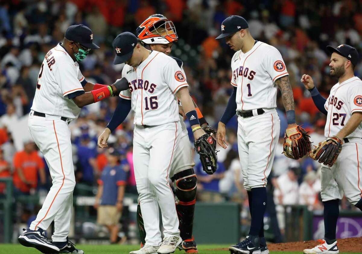 Houston Astros manager Dusty Baker Jr. (12) celebrates with Aledmys Diaz (16) after the Astros beat the Los Angeles Dodgers 5-2 during an MLB baseball game at Minute Maid Park, Wednesday, May 26, 2021, in Houston.