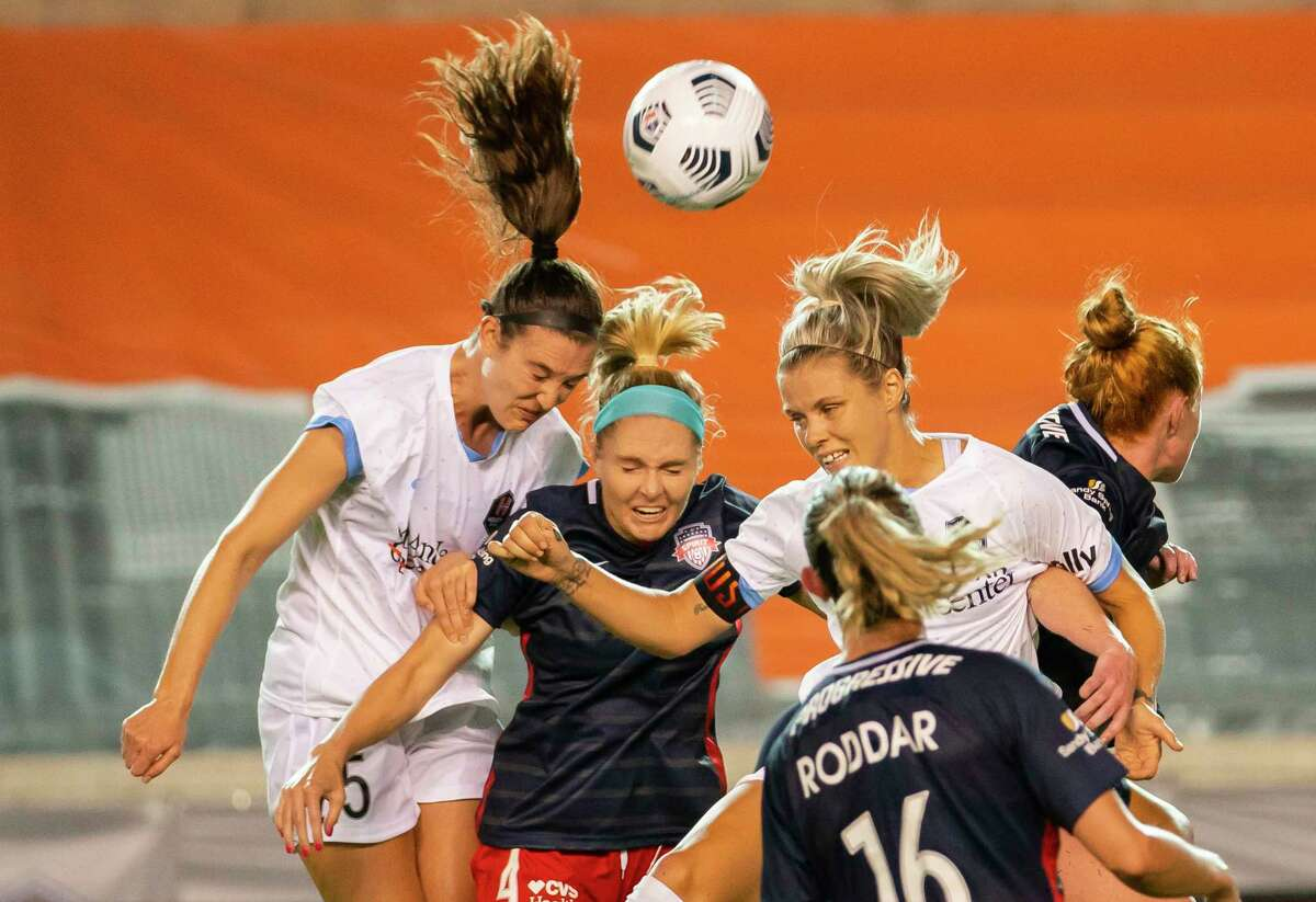 Houston Dash defender Katie Naughton (25) and Houston Dash forward Rachel Daly (3) battle for a header with Washington Spirit defender Natalie Jacobs (4) during the second half of a 2-1 loss by the Houston Dash to the Washington Spirit on Wednesday, May 26, 2021, at BBVA Stadium in Houston.
