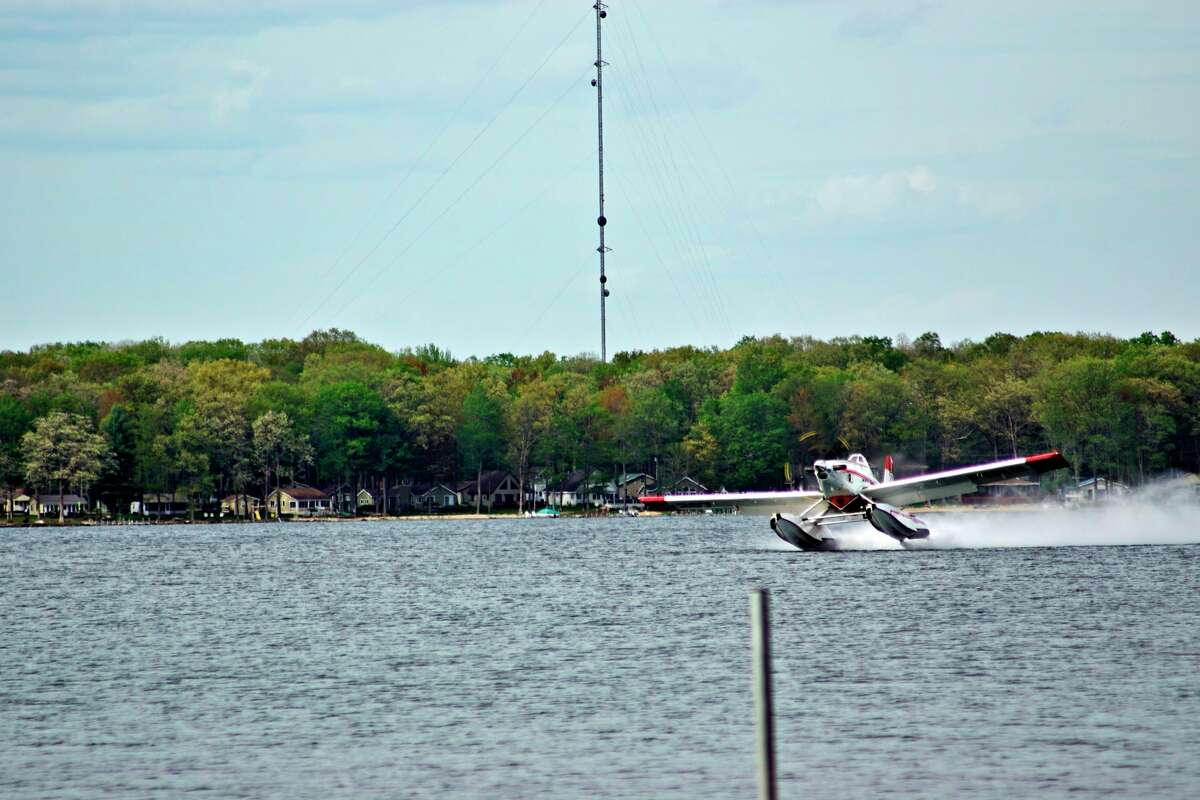 A U.S. Forest Service plane was buzzing the lake to fill its pontoon with water on Friday, May 21 to fight the fire in the Baldwin area. (Pioneer photo/David Roberts)