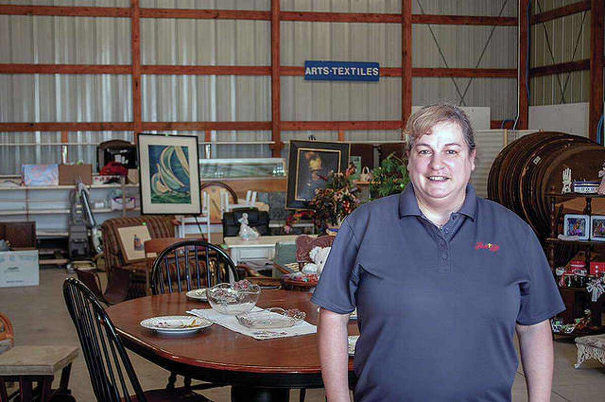 Katie Pinkston, a major with The Salvation Army in Jacksonville, stands in one of two buildings being set up for Friday and Saturday's annual Flea-Esta sale at the Morgan County Fairgrounds.