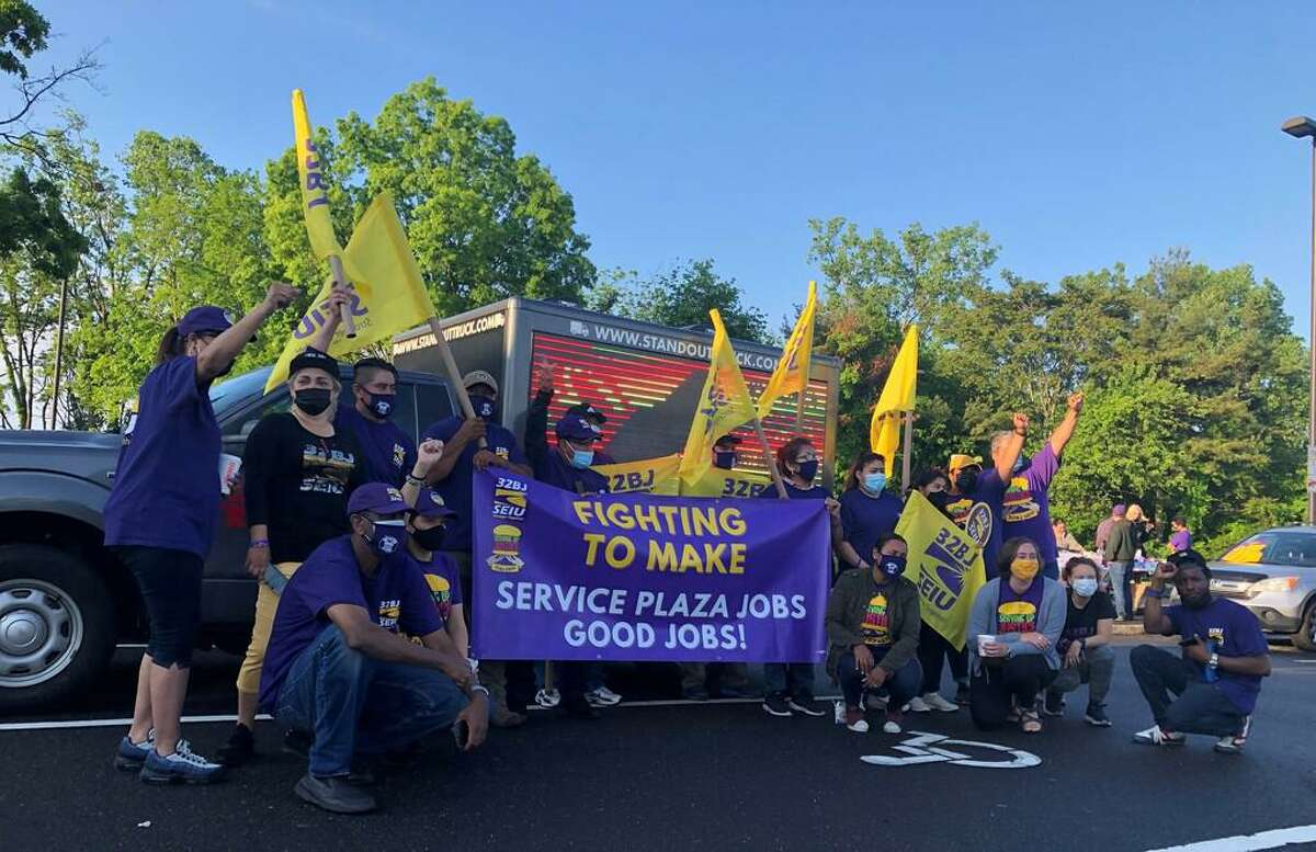 Workers at the McDonald's on Interstate-95 North in Branford and Darien, represented by SEIU 32BJ, launched a one-day strike Thursday, arguing they should be provided benefits as state subcontractors.