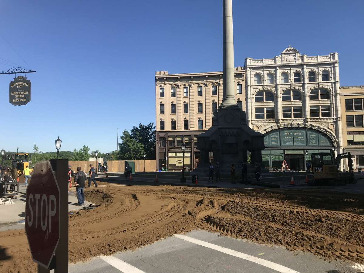 """Crews spread soil around Monument Square in Troy to give it a period look for HBO's """"The Gilded Age,"""" which is filming in Troy."""