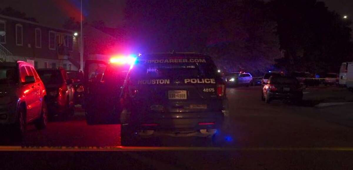 A bullet grazed the head of a woman after two men who held her elderly mother at gunpoint fired in her direction early Thursday morning in southeast Houston, according to police.