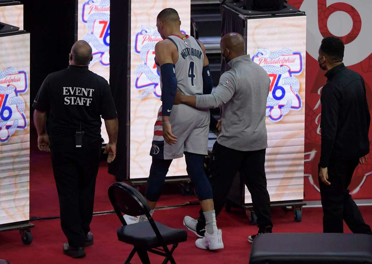 Washington Wizards guard Russell Westbrook walks off court just before a fan pours popcorn on him in the fourth quarter.