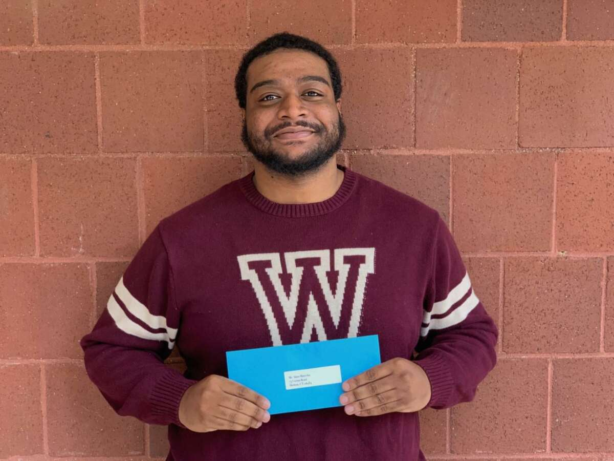 Alain Marcelin, who will receive his bachelor's degree in business administration from Post University, was recently awarded a Boys and Girls Club of Lower Naugatuck Valley scholarship.