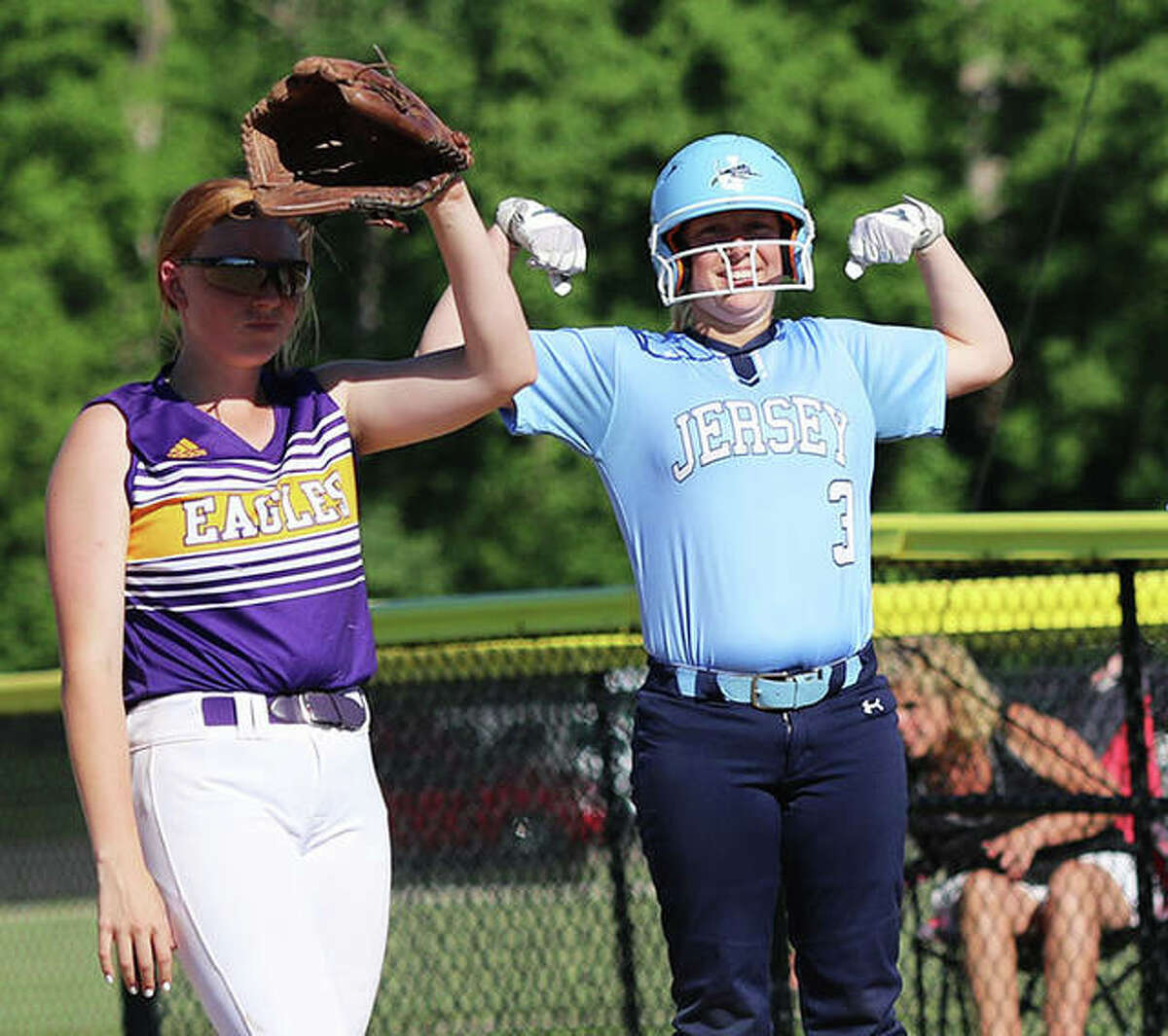 Jersey's Shelby Koenig (right) reacts to teammates in the dugout after her soft single to left field while CM first baseman Ally Hardy shields the sun on Wednesday at the Bethalto Sports Complex.
