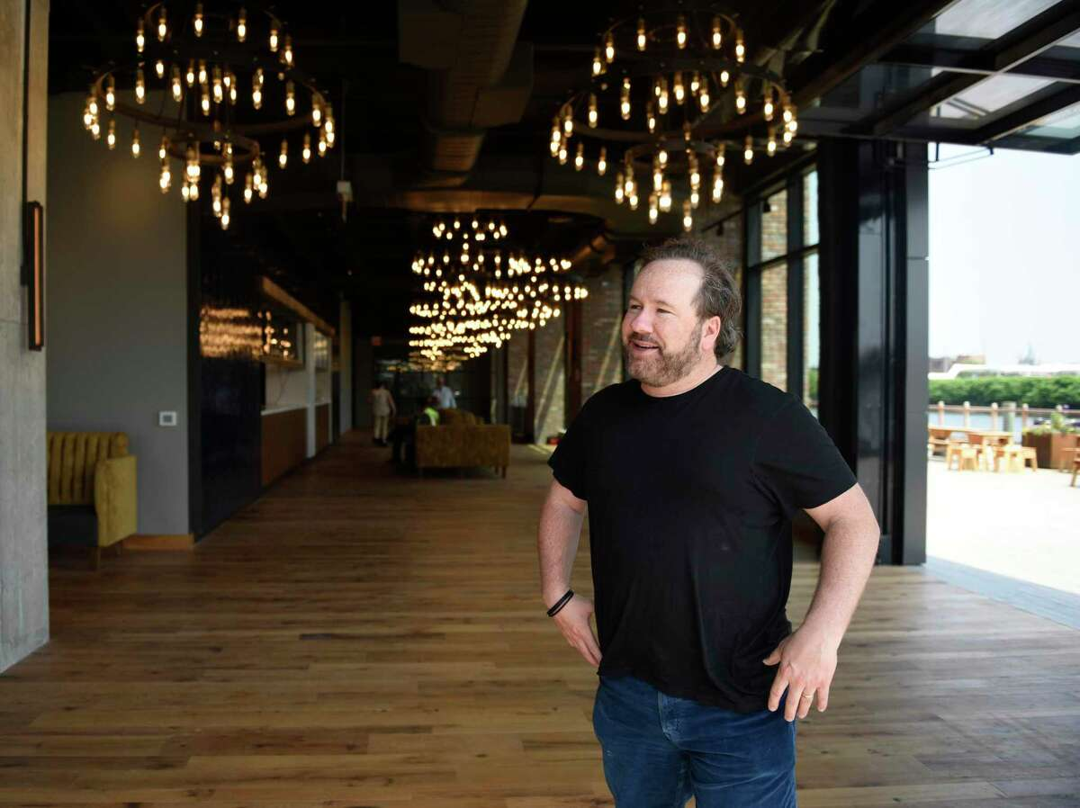 Wheelhouse CEO Brent Montgomery shows the restaurant and Cisco Brewers space within The Village commercial office space in Stamford, Conn. Wednesday, May 26, 2021. The Village is a premium work-play environment featuring anchor tenants Wheelhouse Entertainment, ITV America, and Cisco Brewers.