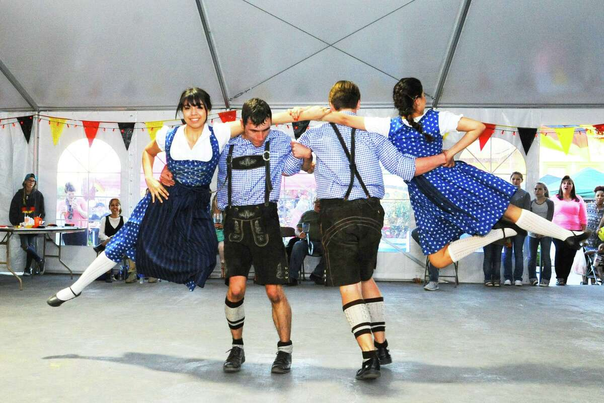 Tomball residents and visitors enjoy a day of fun at the Tomball German Heritage Festival in downtown Tomball. Dancing, food, shopping and carnival rides were enjoyed by all.