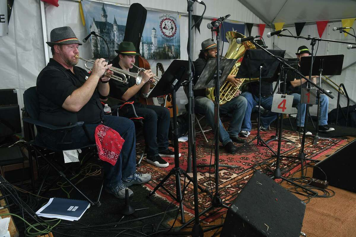 Mark Wootton, left, and his fellow members of the Home Brewed Brass Ensemble from Houston, perform during the Tomball German Heritage Festival at the Tomball Depot on March 30, 2019.