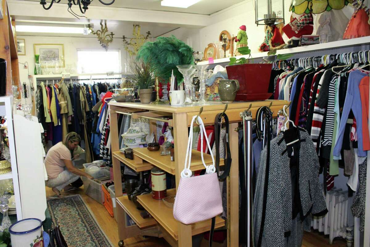 Shoppers browse items at the New Canaan Thrift Shop in a previous year. The Thrift Shop is having its first Grand Summer Tag Sale on Saturday, June 12, from 10 a.m. to 4 p.m., in the town's Locust Avenue parking lot, which is adjacent to the thrift shop. All social distancing rules will apply at the event amid the coronavirus pandemic.