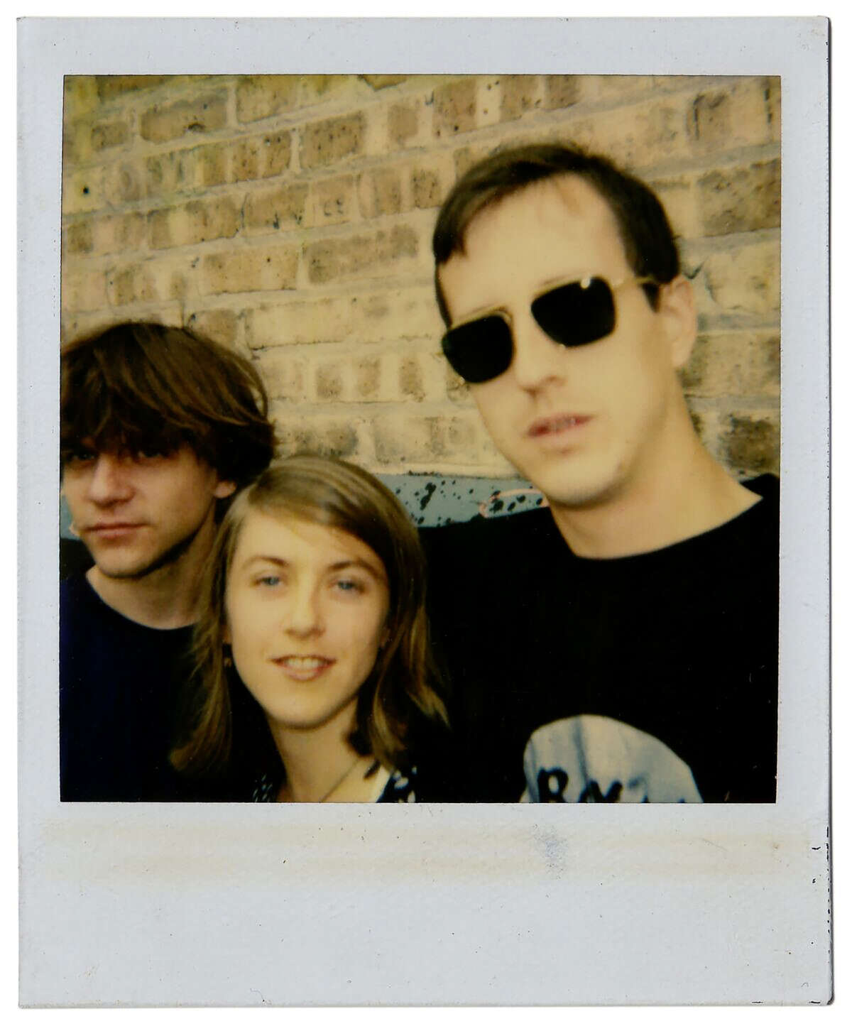 Casey Rice, Liz Phair and Brad Wood appear outside Idful Music Corp. in 1993.