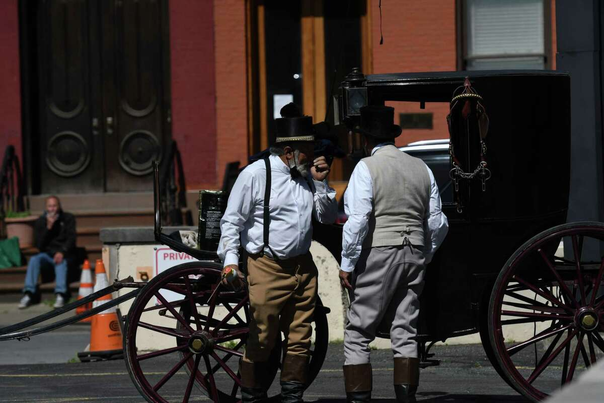 Horse drawn carriages are prepared for filming in the HBO series 'Gilded Age' on Thursday morning, May 27, 2021, in a parking lot across from Tory Music Hall in Troy, N.Y. (Will Waldron/Times Union)