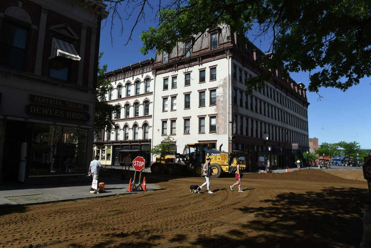 Dirt is spread across the streets of Troy's Monument Square for filming in the HBO series 'Gilded Age' on Thursday morning, May 27, 2021, in Troy, N.Y. (Will Waldron/Times Union)