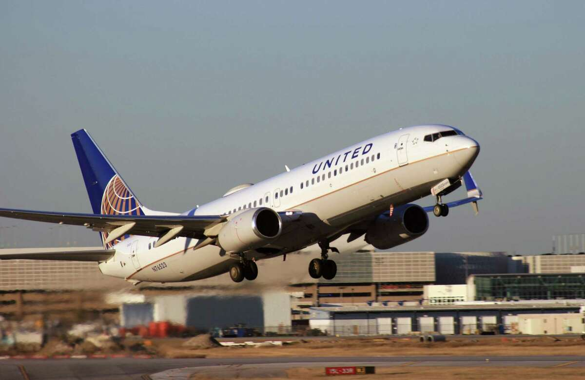 A United Airlines Boeing 737 takes off from Bush Intercontinental Airport.