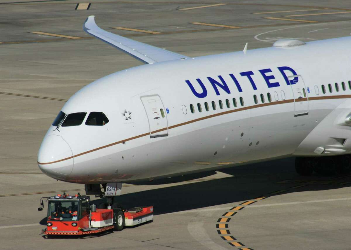 A United Airlines is towed to a gate atBush Intercontinental Airport.