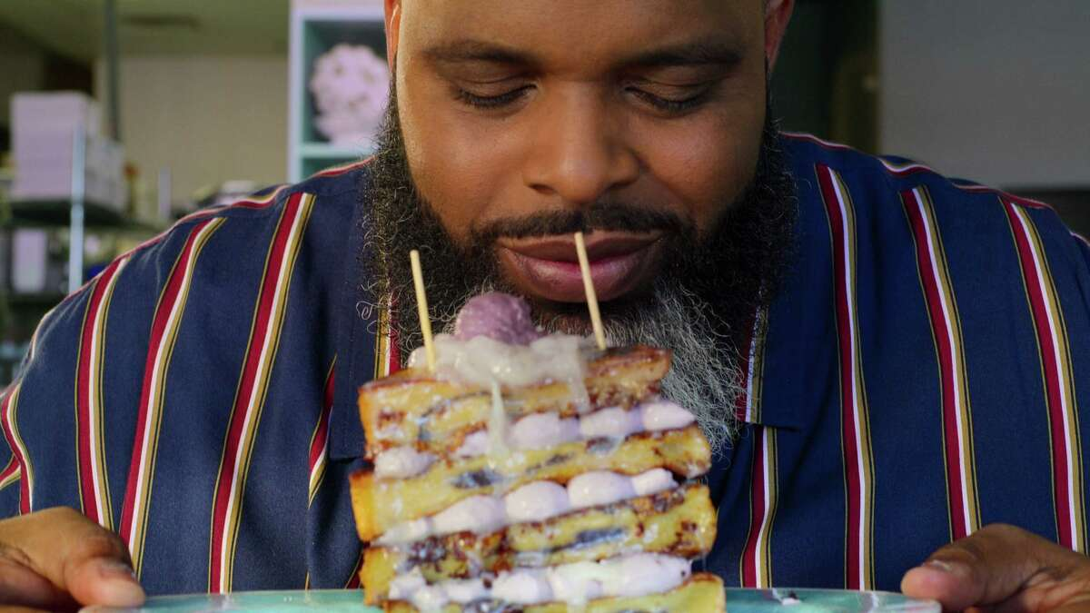 """Daymon """"Daym Drops"""" Patterson tasting the ube French toast by Magnolia Magat of Truffles N' Bacon Cafe during the Las Vegas episode."""