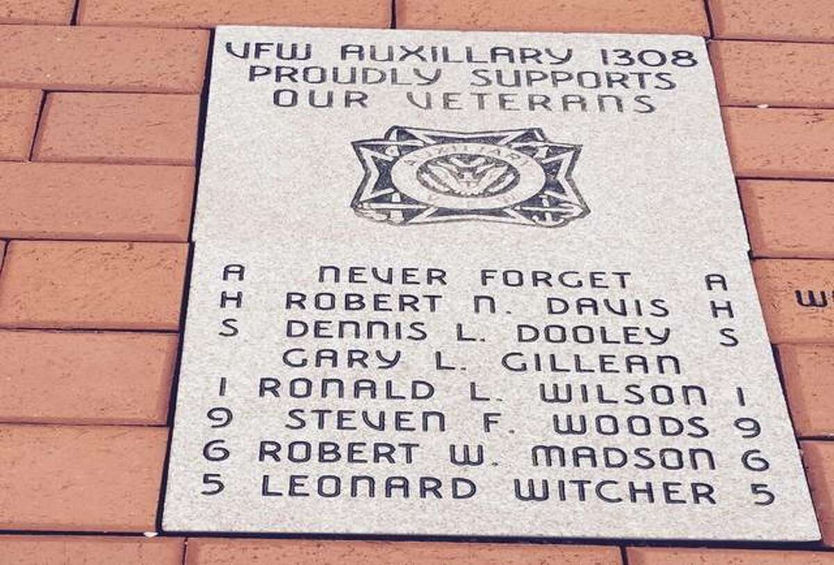 A memorial brick at the VFW Post 1308 lists seven members of Alton High School's Class of 1965 who died in the Vietnam War.