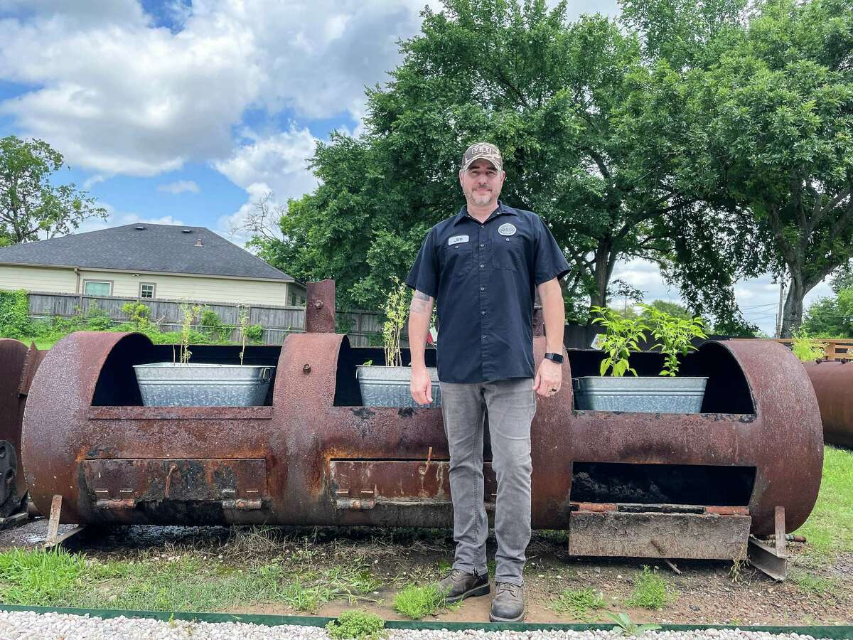 Jim Buchanan with repurposed pits at Dozier's BBQ