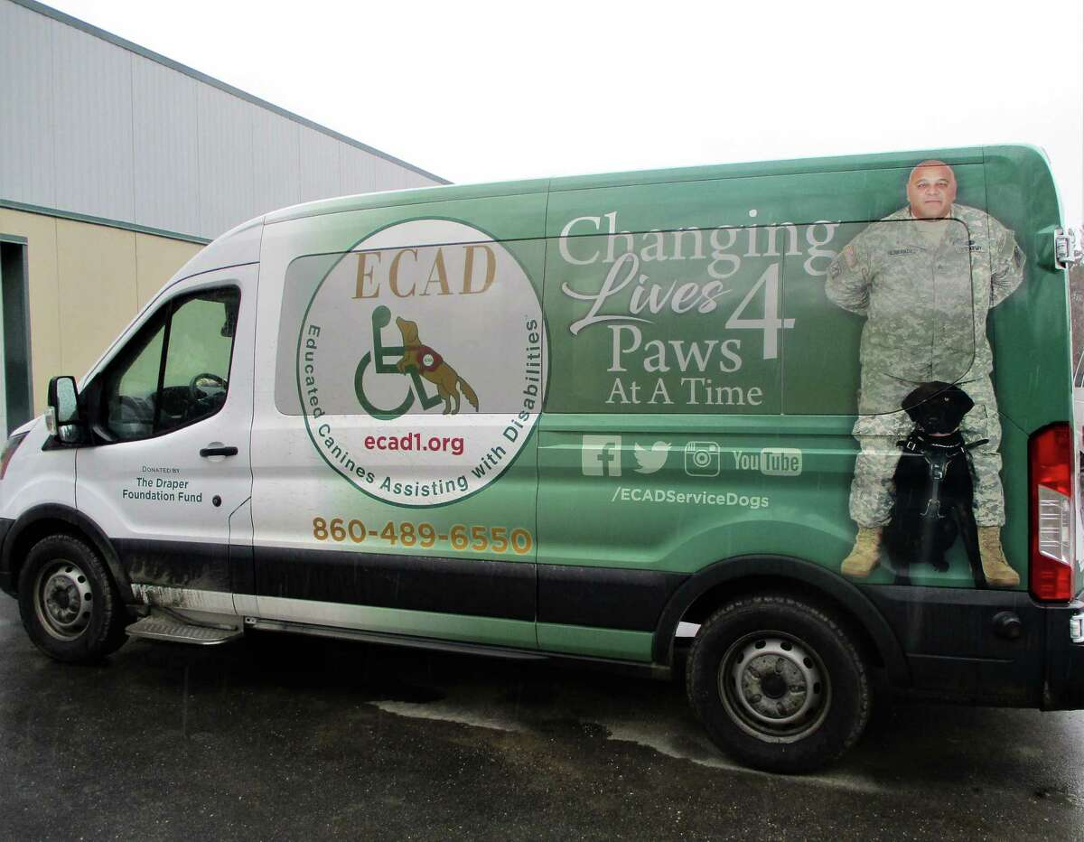 The Planning & Zoning Commission conditionally approved a special permit to expand Educated Canines Assisting with Disabilities' operations on Newfield Road. Those conditions, according to the owner, need a review before they're accepted. Pictured is the ECAD van, which was donated by the Draper Foundation Fund.
