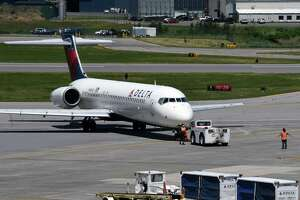 A Delta jet is pushed back from the gate at Albany International Airport on Thursday, May 27, 2021, in Colonie, N.Y. (Will Waldron/Times Union)