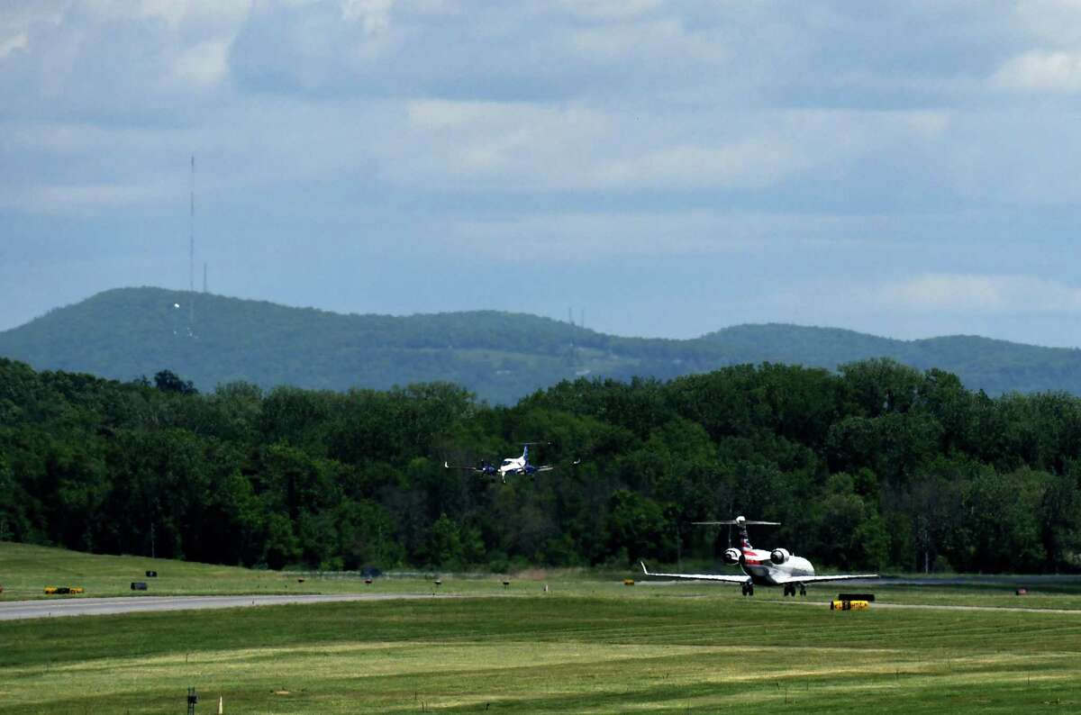 Aircraft land and prepare for takeoff at Albany International Airport on Thursday, May 27, 2021, in Colonie, N.Y. (Will Waldron/Times Union)