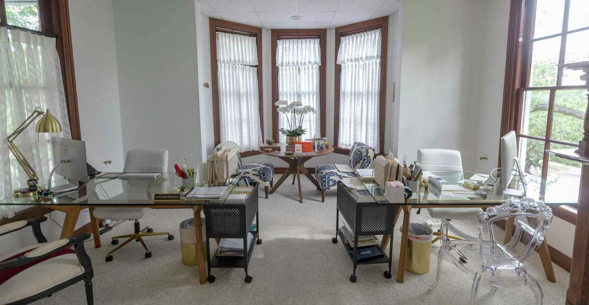 The second floor office, leased by the advertising and public relations agency TradeCraft, also combines vintage details from the original house along with modern amenities needed to run a 21st century business.