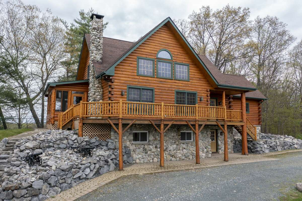 If you like the wall-t0-wall wood look, this place is for you. The log house at 2989 River Road in Schaghticoke was built in 2003 on high country above the Hudson River. The house has 3,640 square feet of living space, three bedrooms and three bathrooms. It's on a five-acre. Highlights include extensive custom wood and stone work. In addition to a deck that runs the length of the house, there's a screened deck off the side of the house. The interior has an open layout and the kitchen has an oversize commercial grade range. The furnishings are also available for sale. Mechanicville schools. Taxes (without STAR): $10,220. List price: $749,000. Contact listing agent Gary Squires of Roohan Realty at 518-879-0935 https://realestate.timesunion.com/listings/2989-River-Rd-Schaghticoke-TOV-NY-12121-MLS-202117763/52422574