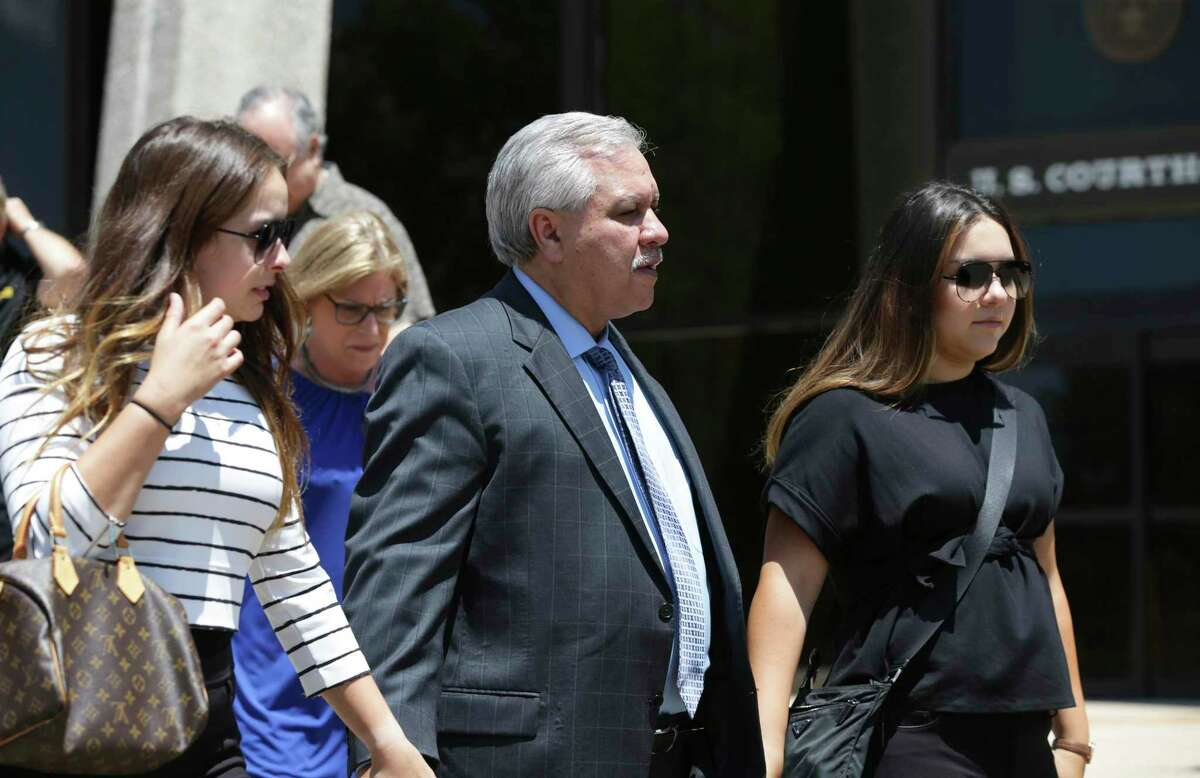 Victims of a fraud that landed Gary Cain, center, in federal prison will get at least $171,000 from the sale of his Shavano Park estate. Cain and other defendants were ordered to pay the victims $6.3 million in restitution. The house was Cain's only significant asset.