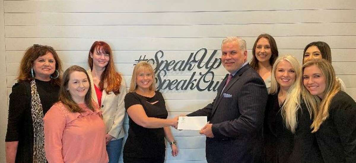 Montgomery County District Attorney Brett Ligon is seen on May 25, 2021 presenting an $8,500 check to the Montgomery County Women's Center.