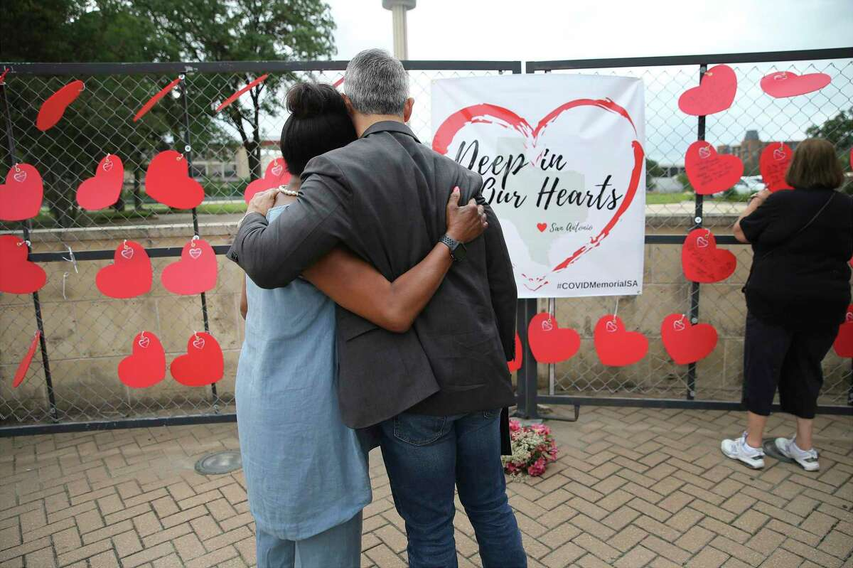 Mayor Ron Nirenberg offers a hug to Sharon Swisher whose husband died from Covid-19 as the City of San Antonio, Bexar County and the community honor more than 3,400 lives lost to the coronavirus with a memorial at Hemisfair near Alamo and Market Streets on Thursday, May 27, 2021.