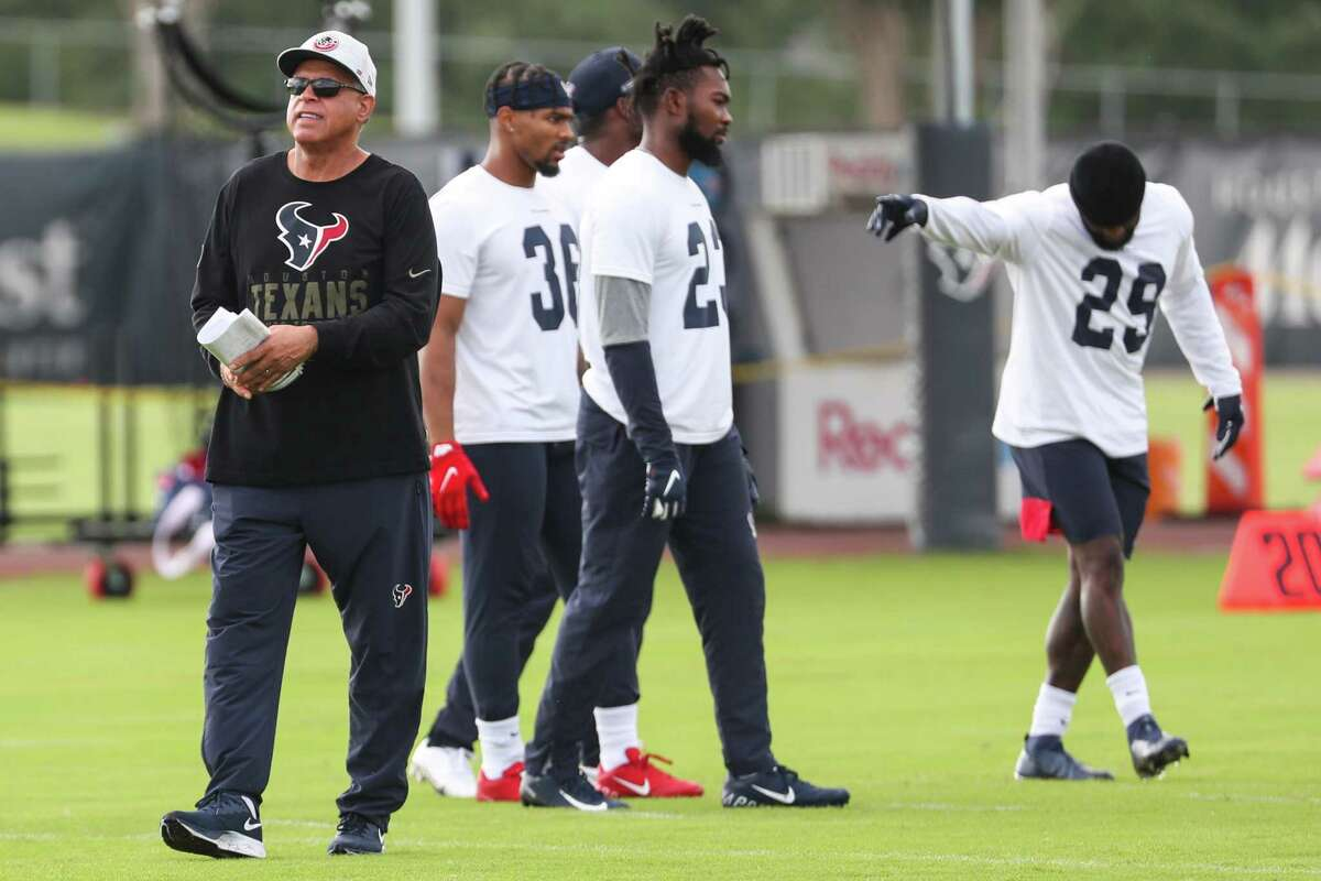 Texans head coach David Culley, left, works with the defensive backs during team OTAs on Thursday at the Houston Methodist Training Center.