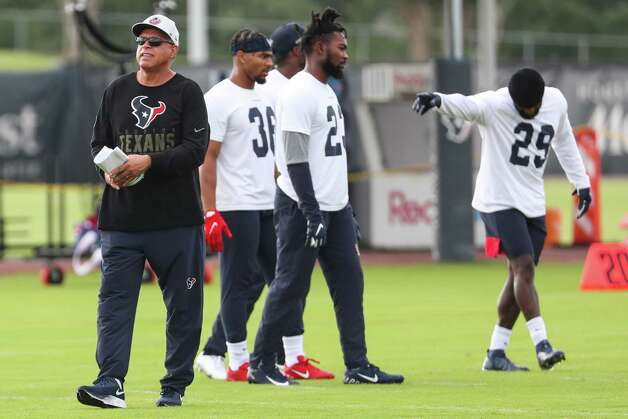 Houston Texans head coach David Culley, left, works with the defensive backs during team OTAs on Thursday, May 27, 2021, at The Houston Methodist Training Center in Houston. Photo: Brett Coomer, Staff Photographer / © 2021 Houston Chronicle