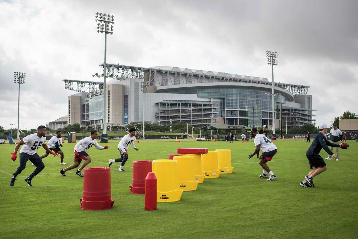 Houston Texans linebackers work out in the shadow of NRG Stadium during team OTAs on Thursday, May 27, 2021, The Houston Methodist Training Center in Houston.